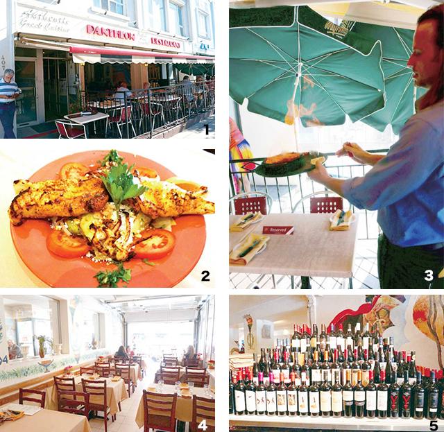 1 グリーク料理を楽しむたくさんの人々   2  サイズとテイストが自慢のCALAMARI  3  フランベのパフォーマンスは必見 4  広々とした店内 5  料理と共に楽しめるワインもたくさん用意されている