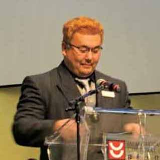 開会の挨拶を述べる新日系コミッティー(NJCC)の福島次郎代表